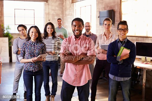 502281620 istock photo Portrait Of Staff Standing In Modern Design Office 502281304