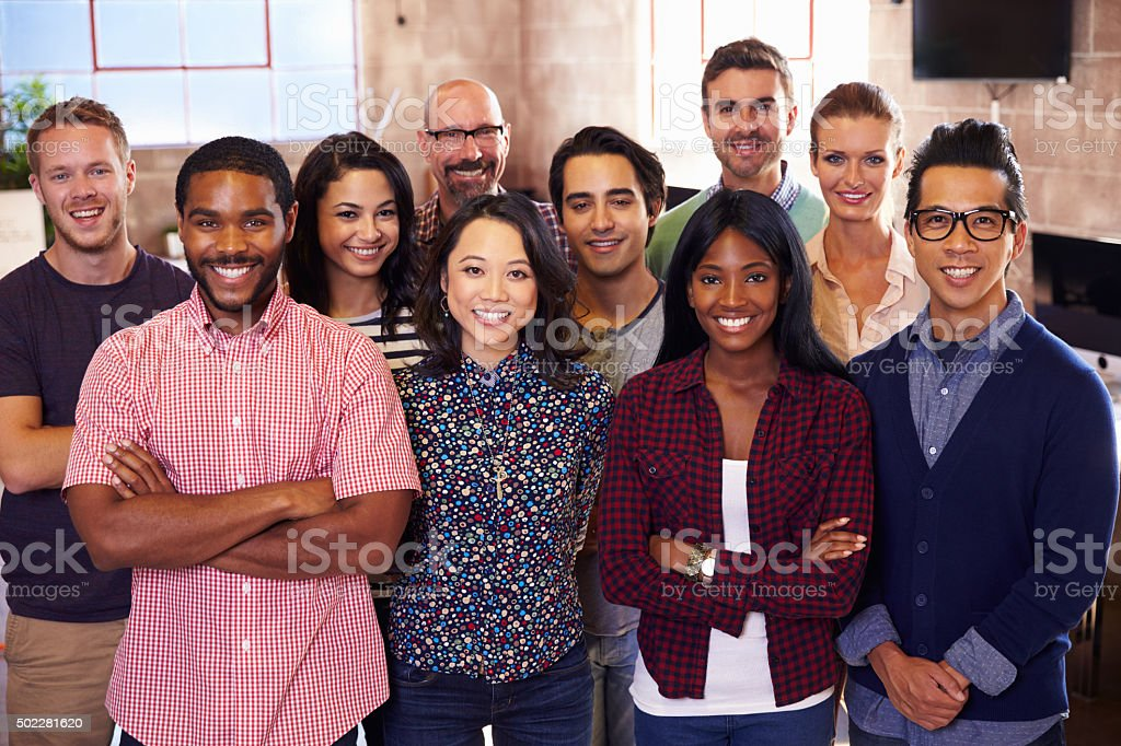 Portrait Of Staff Standing In Modern Design Office stock photo