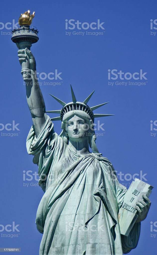 Portrait of statue of liberty with clear blue sky background Statue of Liberty (New York) American Culture Stock Photo