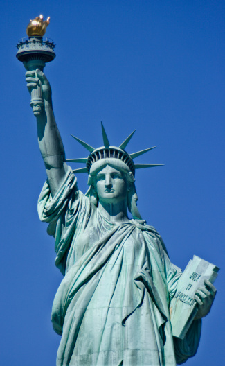 Portrait Of Statue Of Liberty With Clear Blue Sky Background Stock Photo - Download Image Now