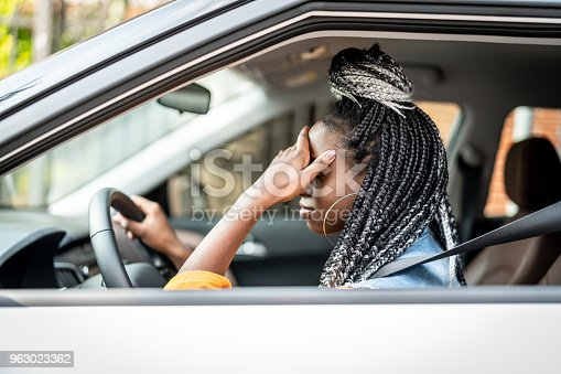 istock Portrait of Stressed African Woman In Car 963023362