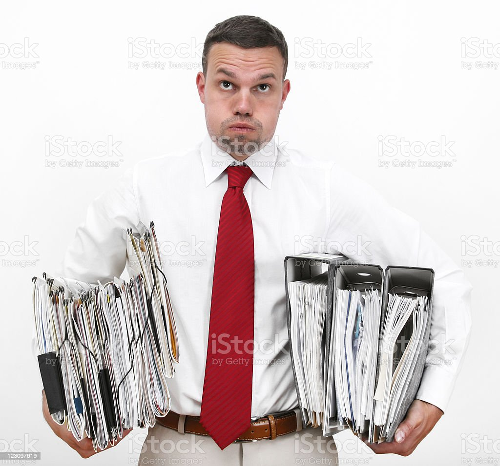 Portrait Of Stressed Businessman Holding Several Binders royalty-free stock photo