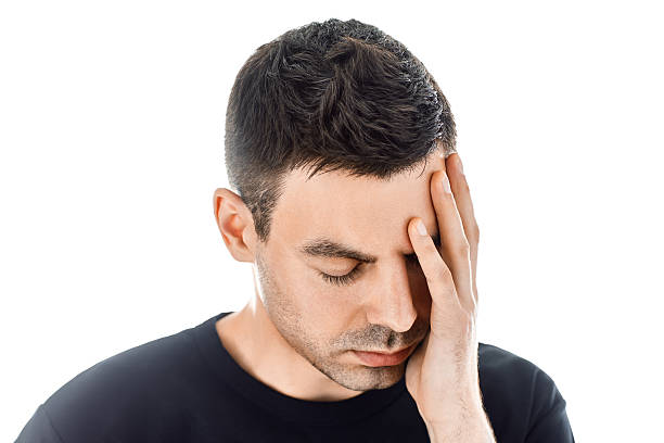 Portrait of stressed man having headache isolated on white backg - foto de stock