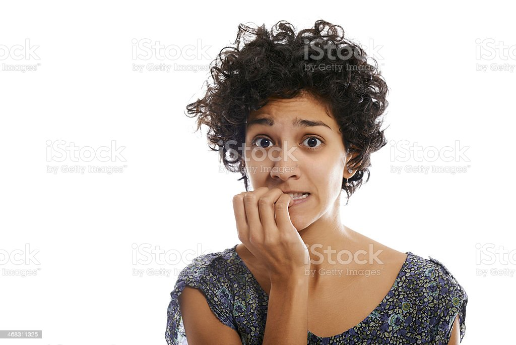 portrait of stressed woman biting fingernail stock photo