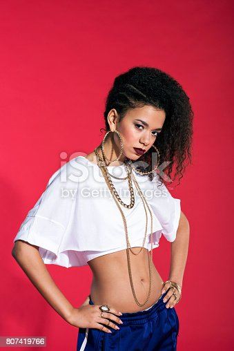 807419930istockphoto Portrait of strong latin young woman in chola style 807419766