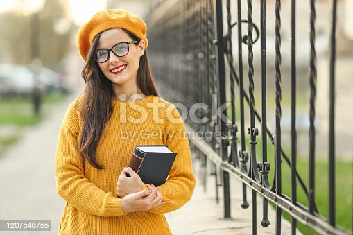 521911045 istock photo Portrait of student holding book 1207548755