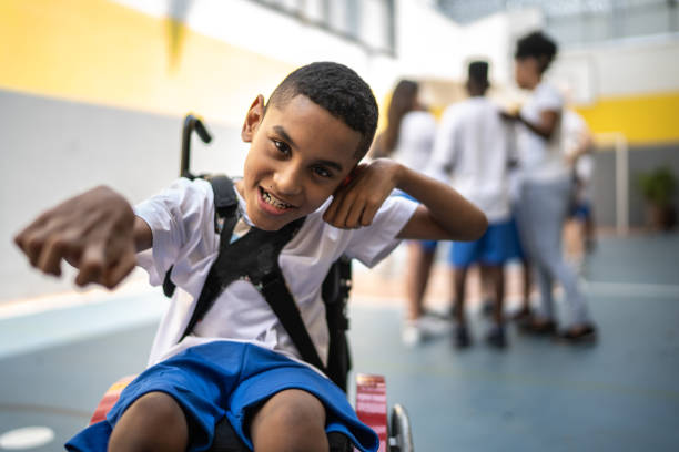 Portrait of student with disability in sports court at school stock photo