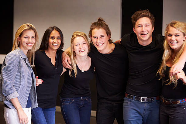 Portrait Of Students With Teacher At Drama College stock photo