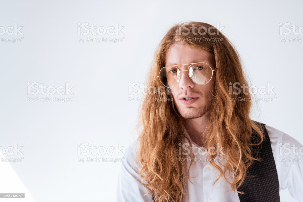 portrait of stylish businessman with curly ginger hair on white royalty-free stock photo