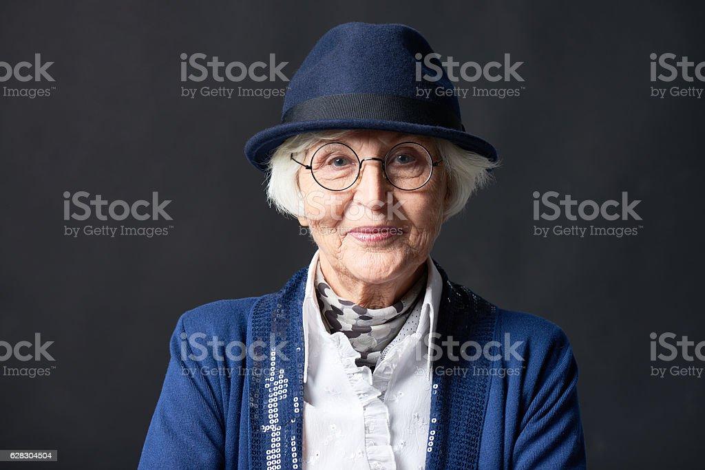 Portrait of stylish elderly woman stock photo