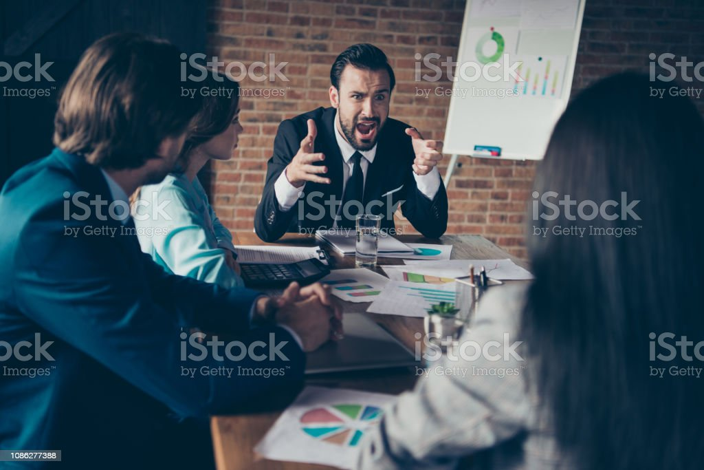 Portrait of stylish elegant classy angry chairman company founde Portrait of stylish elegant classy angry chairman company founder director employer having disagreement with employees at workplace workstation Adult Stock Photo