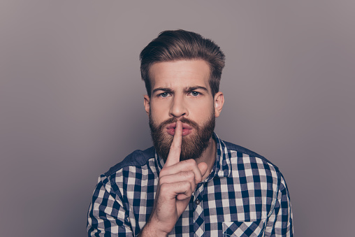 636829368 istock photo portrait of stylish man with beard show sign silence 636831224