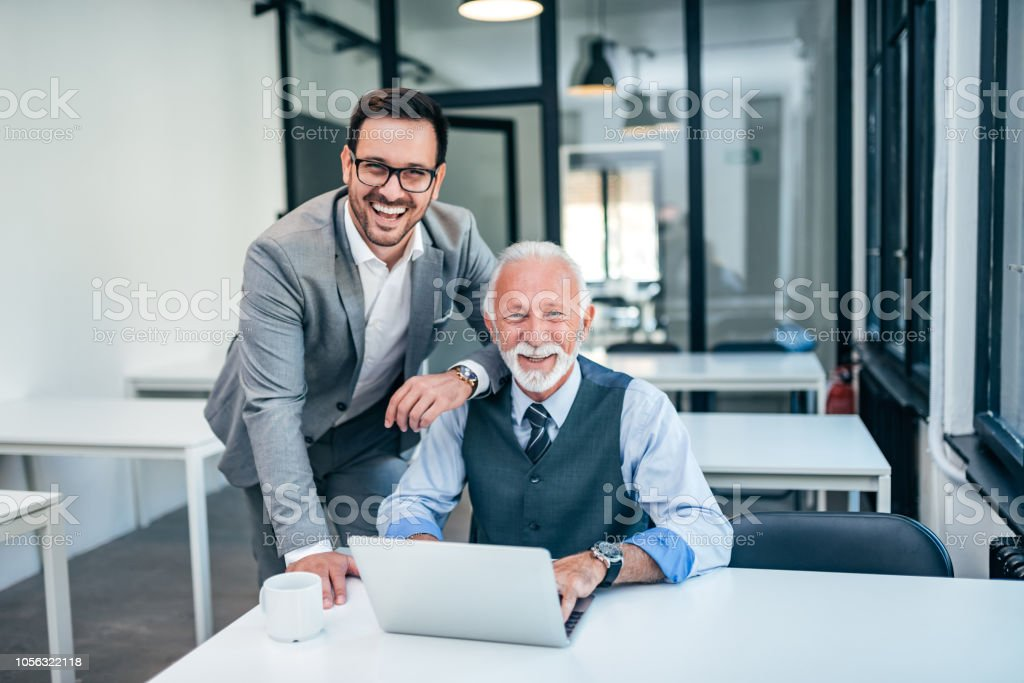 Portrait of successful business family at work. - Royalty-free Active Seniors Stock Photo