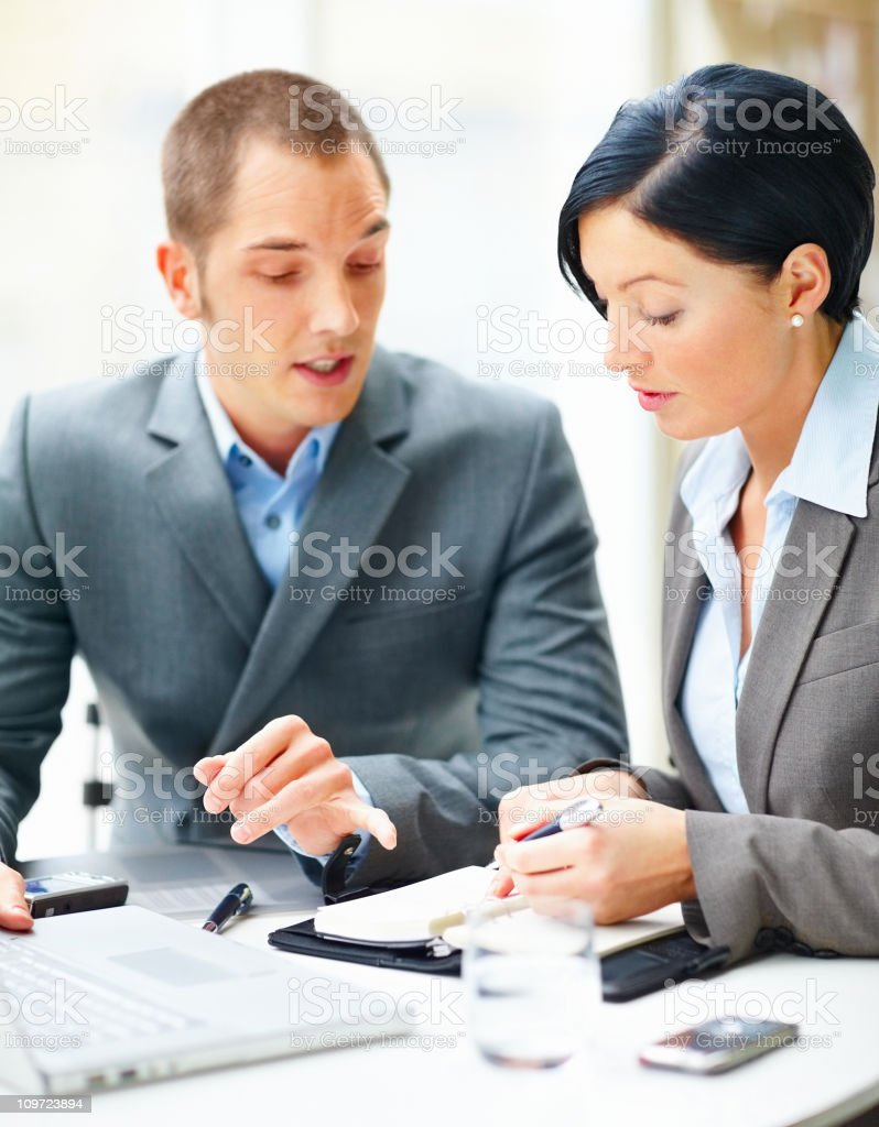 Portrait of successful business people discussing together royalty-free stock photo
