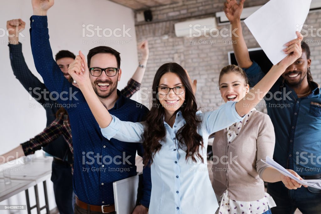 Portrait of successful business team posing in office stock photo