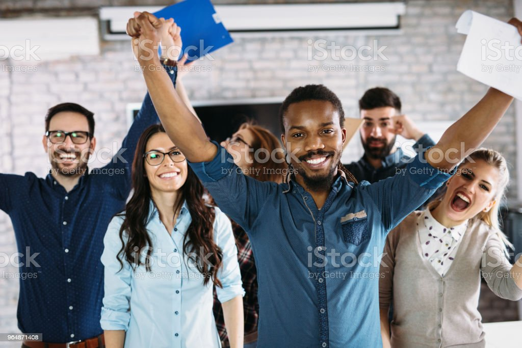Portrait of successful business team posing in office royalty-free stock photo