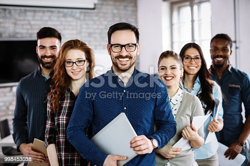 istock Portrait of successful business team posing in office 998453038
