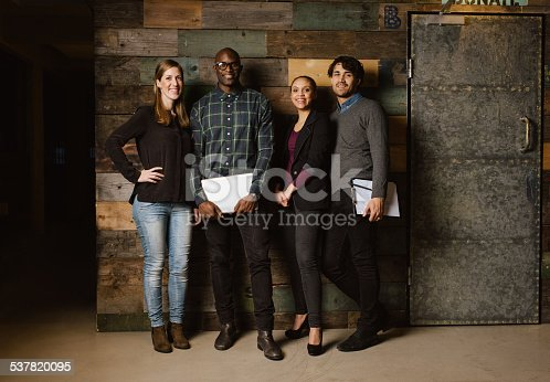 istock Portrait of successful business team standing in an office 537820095
