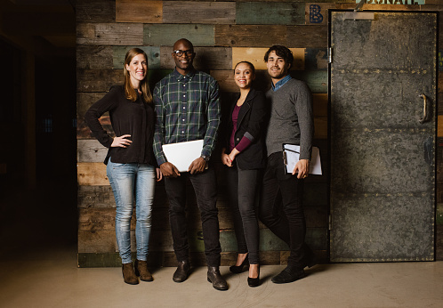 514325215 istock photo Portrait of successful business team standing in an office 537820095