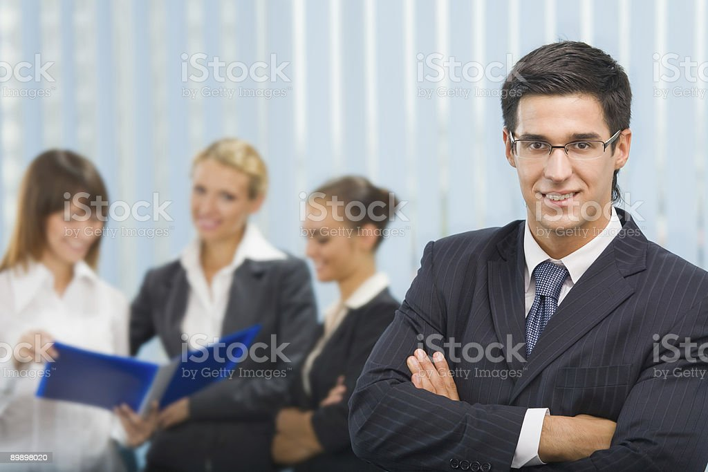 Portrait of successful businessman and business team at office royalty free stockfoto