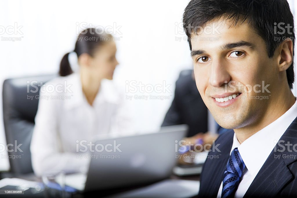 Portrait of successful businessman and colleagues on background, at office royalty-free stock photo
