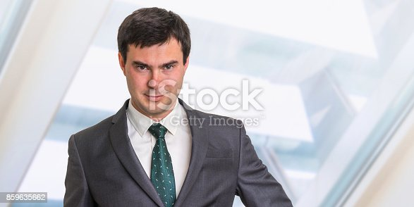 istock Portrait of successful businessman in formal suit 859635662