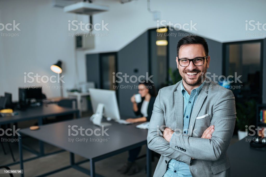 Portrait of successful businessman. Looking at camera with arms crossed. stock photo