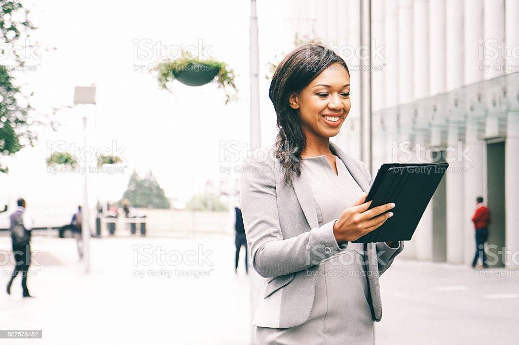 Portrait Of Successful Businesswoman Using Tablet In Urban Landscape stock photo