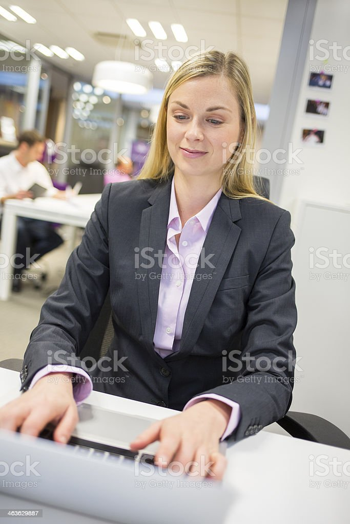 Portrait of successful businesswoman working with laptop in office royalty-free stock photo