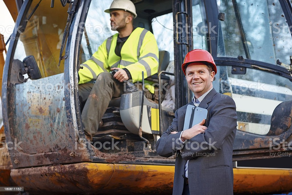 Portrait of successful contractor at construction site stock photo