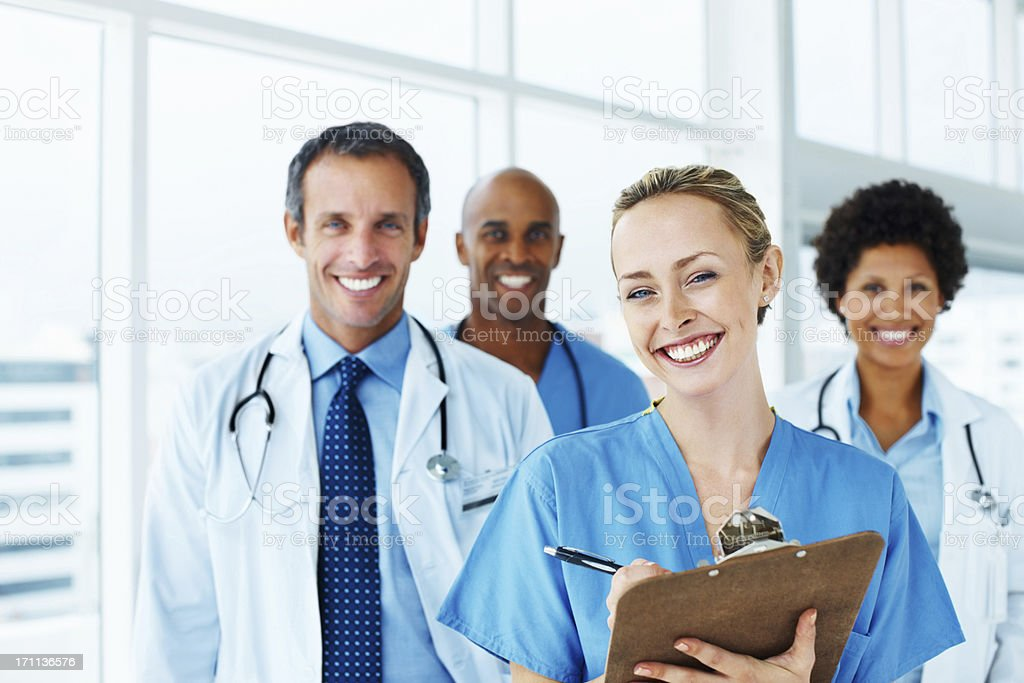 Portrait of successful doctors standing together royalty-free stock photo