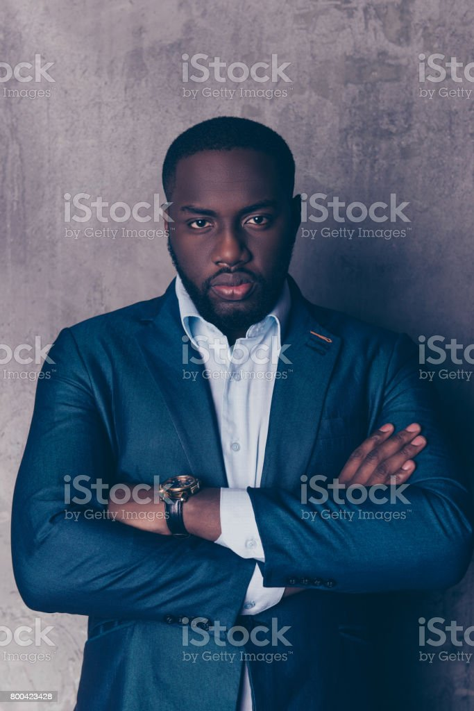 Portrait of successful  handsome afroamerican man in stylish suit crossed hands stock photo