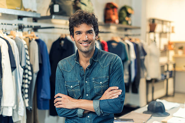 Portrait of successful male owner  with crossed arms in clothing stock photo
