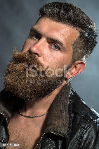 istock Portrait of sullen unshaven man 487152160