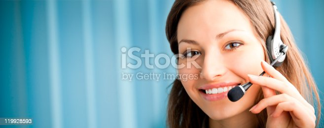 1167562098 istock photo Portrait of support phone operator in headset at workplace 119928593