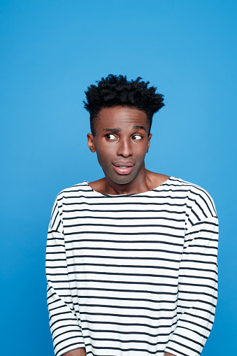 Portrait Of Surprised Afro American Guy Stock Photo - Download Image Now