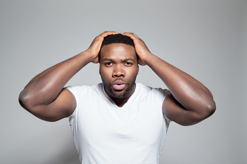 Portrait Of Surprised Afro American Young Man Stock Photo - Download Image Now