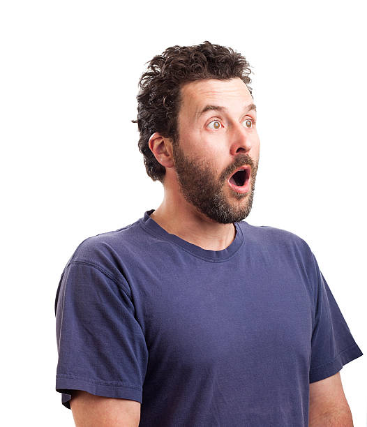 Portrait of surprised bearded European man stock photo