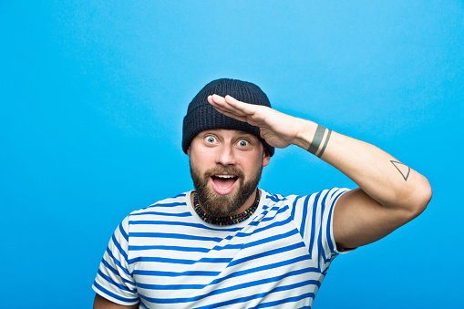 Portrait Of Surprised Bearded Sailor Against Ble Background Stock Photo - Download Image Now