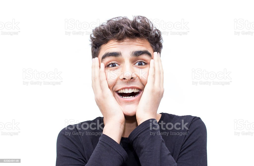 Portrait of surprised boy over white background stock photo