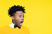 istock Portrait of surprised geeky young man looking away 996839612