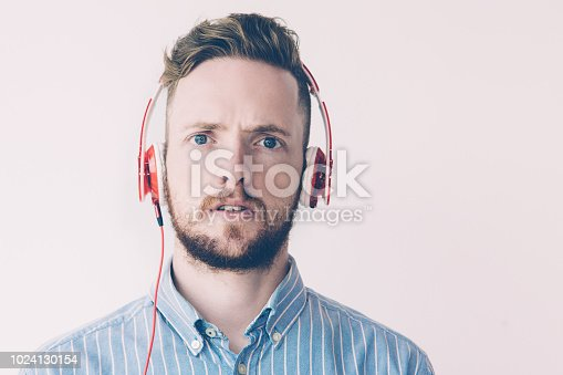 istock Portrait of Surprised Young Man in Headphone 1024130154