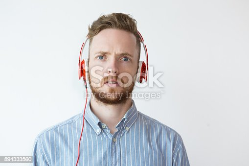 istock Portrait of Surprised Young Man in Headphone 894333560