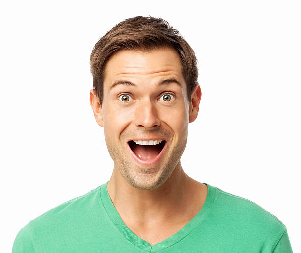 Portrait Of Surprised Young Man Portrait of surprised young man with mouth open over white background. Horizontal shot. mouth open stock pictures, royalty-free photos & images