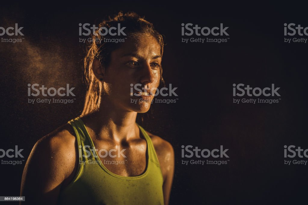 Portrait of sweaty athletic woman looking away. royalty-free stock photo