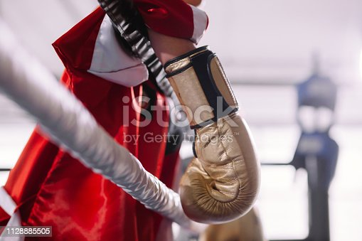 521301688 istock photo portrait of sweaty exhausted boxer resting after difficult fight. 1128885505