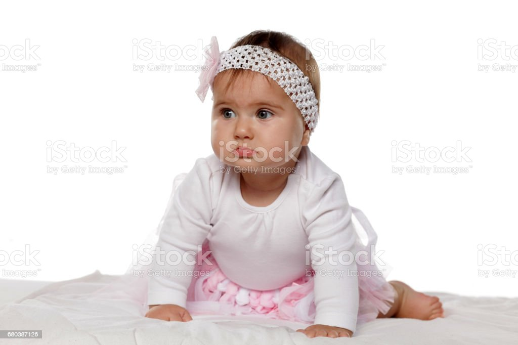 portrait of sweet baby girl on a white bed royalty-free stock photo