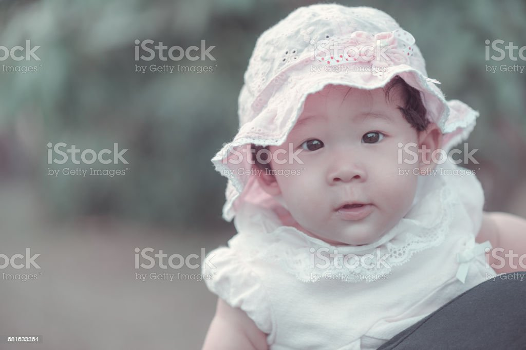 Portrait of sweet little asian baby girl in vintage style. stock photo