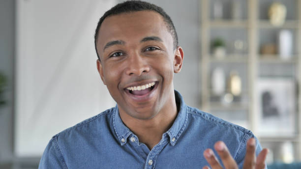 Portrait of Talking Young African Man, Online Video Chat stock photo