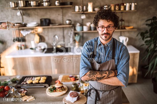 istock Portrait of tattooed chef in the kitchen 1181901712